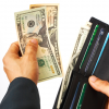 man-paying-a-bill-in-dollars-cash_zyW50EPO-b2